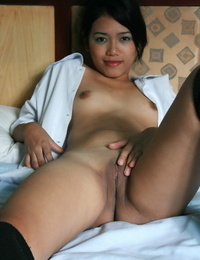 Asian college lady frees her nude ass and trimmed vagina in seized OTK socks