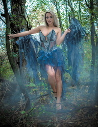 Fairy cosplay chick Nikki Sims doffs her wings and wisp to posture in a panty