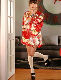 Cute Japanese Marica Hase taunts in kimono before fingering her delicious images