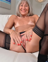 Grey haired granny Leilani Lei shows her little boobs with sunburn lines & her vulva