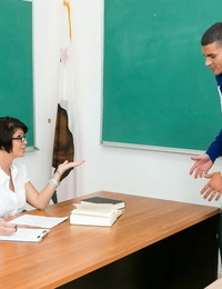 Brief haired cougar Shay Fox seduces a masculine student in her classroom