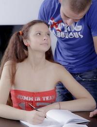 Adorable schoolgirl smallish her boyfriend in striped socks and ponytails