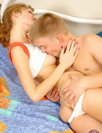 Youthfull looking girl puts her hair in pigtails before railing on top of her bf