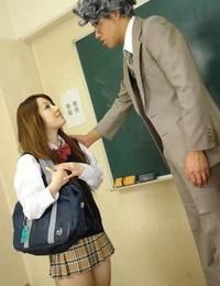 Japanese schoolgirl Ria Sakurai wears cum on face after lovemaking with masculine teachers