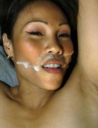 Asian whore Filipino Faye deep-throats the jism from cockslut cocks at a gloryhole