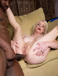 Mature woman Cammille Austin got the biggest ebony hard-on in her life in the ball-sac