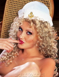 Long-legged woman with curly blonde hair gets dual fucked by sailor gawp