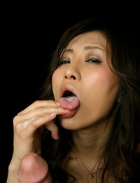 Bare Japanese girl eats jizz from her frigs after a POV handjob