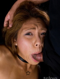 Small Japanese chick is forced to suck a shaft in a cangue and leash