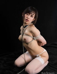 Japanese gimp is face screwed before being wanked in chains and hosiery