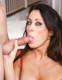 Buxomy brunette Reagan Foxx sucks a cock while providing head