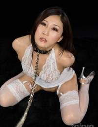 Japanese lady wears a neck corset and leash while huge-chested dick on her knees