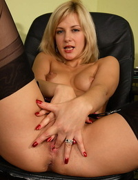 Ash-blonde inexperienced Laurita sinks a lovemaking toy in her labia wearing back seam nylons