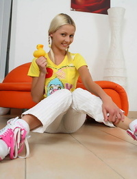 Young blonde chick Pinky June joys her pussy with a rubber duck