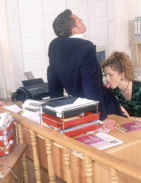 Curly haired secretary from the 70s does a dp at work