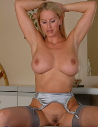 Incredible housewife Adele strips to her rosebutt and unveils exotic knockers