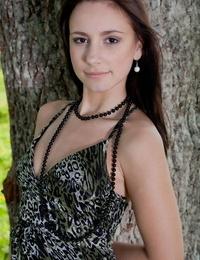 European teenager Karina N shedding satin subjugation and short sundress to stance nude