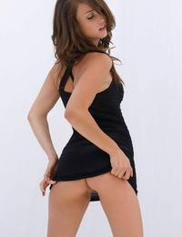 Top rated glamour model Malena Morgan crossing gams in high high-heeled slippers and mini-skirt