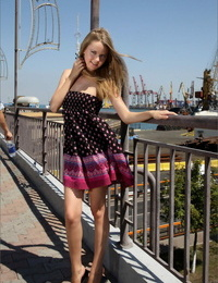 Bold young girl in shot sundress showing her diminutive hooters and bare pussy in public