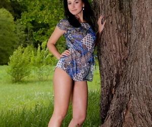 Nice teen Rosalin E models allegiance naked in plump grass orb an old tree