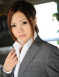 Japanese businesswoman Iroha Kawashima bares her bra before donning glasses