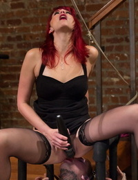 Redhead girl tantalizes a masculine gimp who eats her asshole to save himself