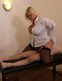Older and younger blondes share a young mans firm shaft on a massage table