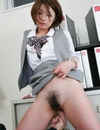 Petite Japanese lady Tsubaki demonstrates her vagina while screwing a co-worker