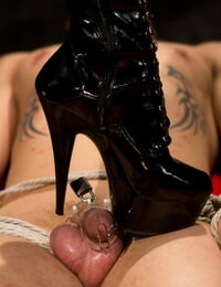 Ash-blonde domme Lorelei Lee submits a masculine sub to a CBT session