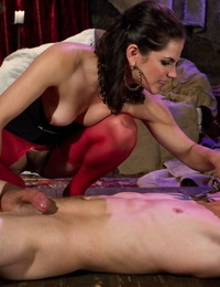 Dark haired nymph Bobbi Starr dominants a restricted dude in crimson nylons