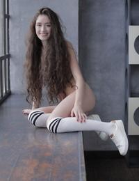 Curly brunette posing - part 84