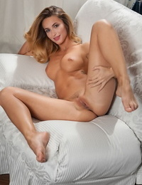 Cara mell shows off her smoking scorching assets as she strips on the sofa - part 381
