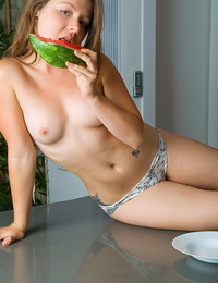 She cuts the watermelon and snacks on it while she does a striptease in her fun - part 710