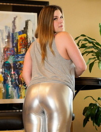 White solo girl Danielle releases her huge ass from her taut trousers