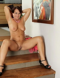 Honey mummy Katherine Ross poses with nude boobies on the stairs