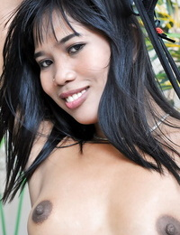 Innocent-looking Asian Anne is toying with her rock hard nipples