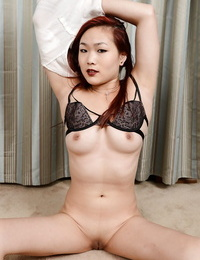 Big-titted Asian amateur plays with puffy shaven cunt after undressing bare