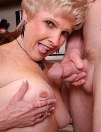 Stocking attired granny Jewel taking jizz flow on tits in kitchen