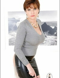 Mature female dom in provocative skirt has some joy with her hooded male pet