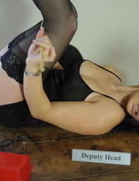 Deputy Headmistress Elise posing in tights and high-heeled shoes with a whip