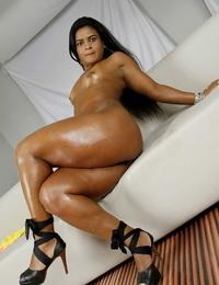 Oiled Latina MILF Ana Julia posing huge huge arse in high high-heeled slippers
