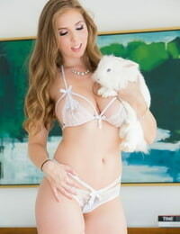 Solo model Lena Paul removes bra and undies in white nylons and high-heeled shoes