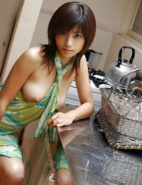 Asian cutie Rin Suzuka uncovering her tits and taking off her panties
