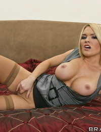 Playful babe Krissy Lynn showcases her hooters and caresses her cunt
