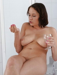 Big-titted European solo girl squirting golden urinate from trimmed pussy