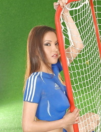 Foxy asian teen with molten ball-sac poses in body painted soccer garb