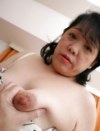 Ball licking action from a black-haired Asian mature Eiko Mamiya