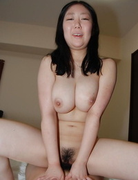 Slutty asian gal with ample mounds gets her fur covered pussy fingered and fucked