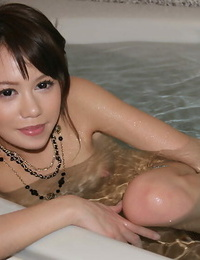 Seductive asian babe with bushy cunt undressing and taking tub