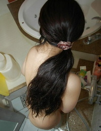 Asian stunner taking shower and rubbing her shaggy images in close up